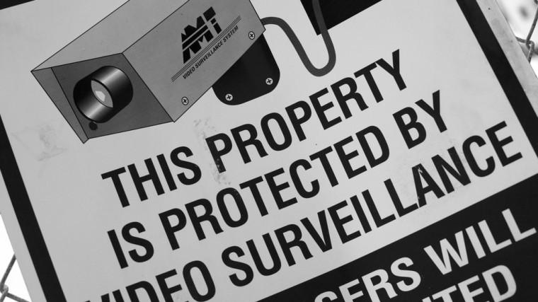 video surveillance, retail, warning sign